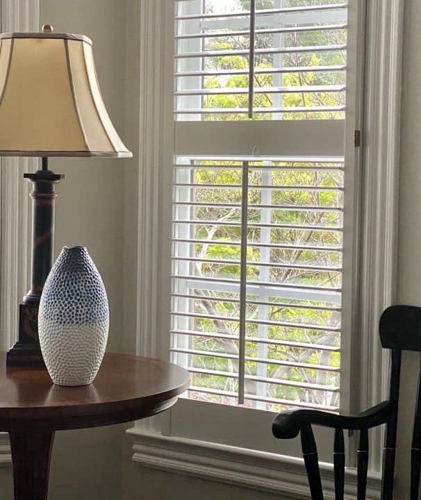 indoor image of generic living room lamp and window to outdoors